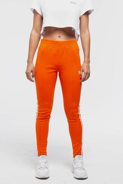 ADIDAS WOMEN'S SST TRACKPANT ORANGE