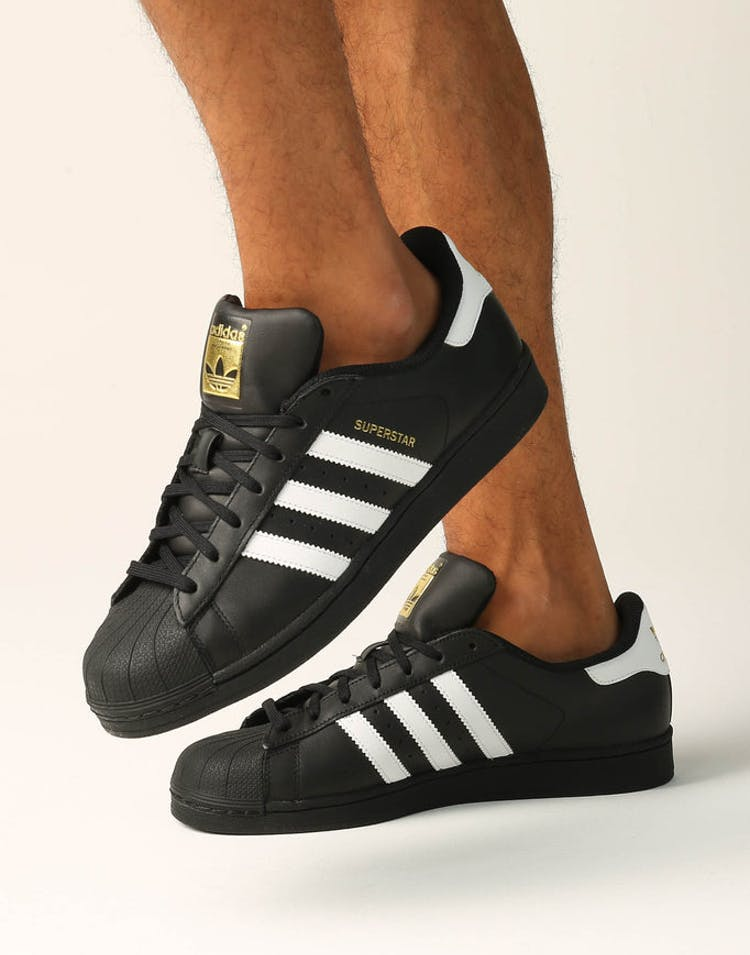 adidas superstar black or white